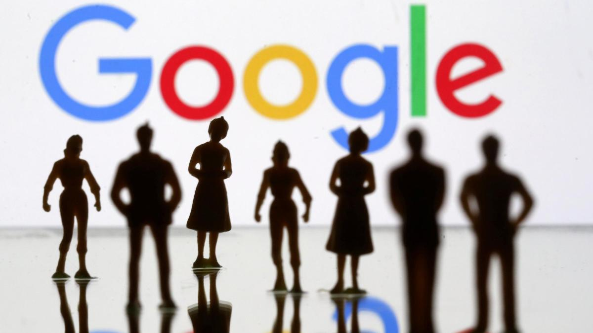 FILE-PHOTO-Small-toy-figures-are-seen-in-front-of-Google-logo-in-this-illustrat
