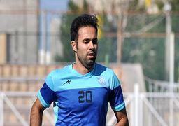 فوتبالیست ایرانی در حال تیراندازی با یک اسلحه گرم+عکس