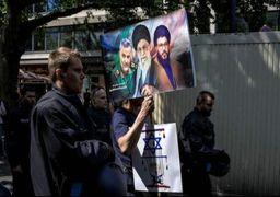 تصویر آیتالله خامنهای و سردار سلیمانی در راهپیمایی آلمان