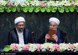 گفتگوی درگوشی برادرزاده و عموی مشهور در مراسم تحلیف روحانی + عکس