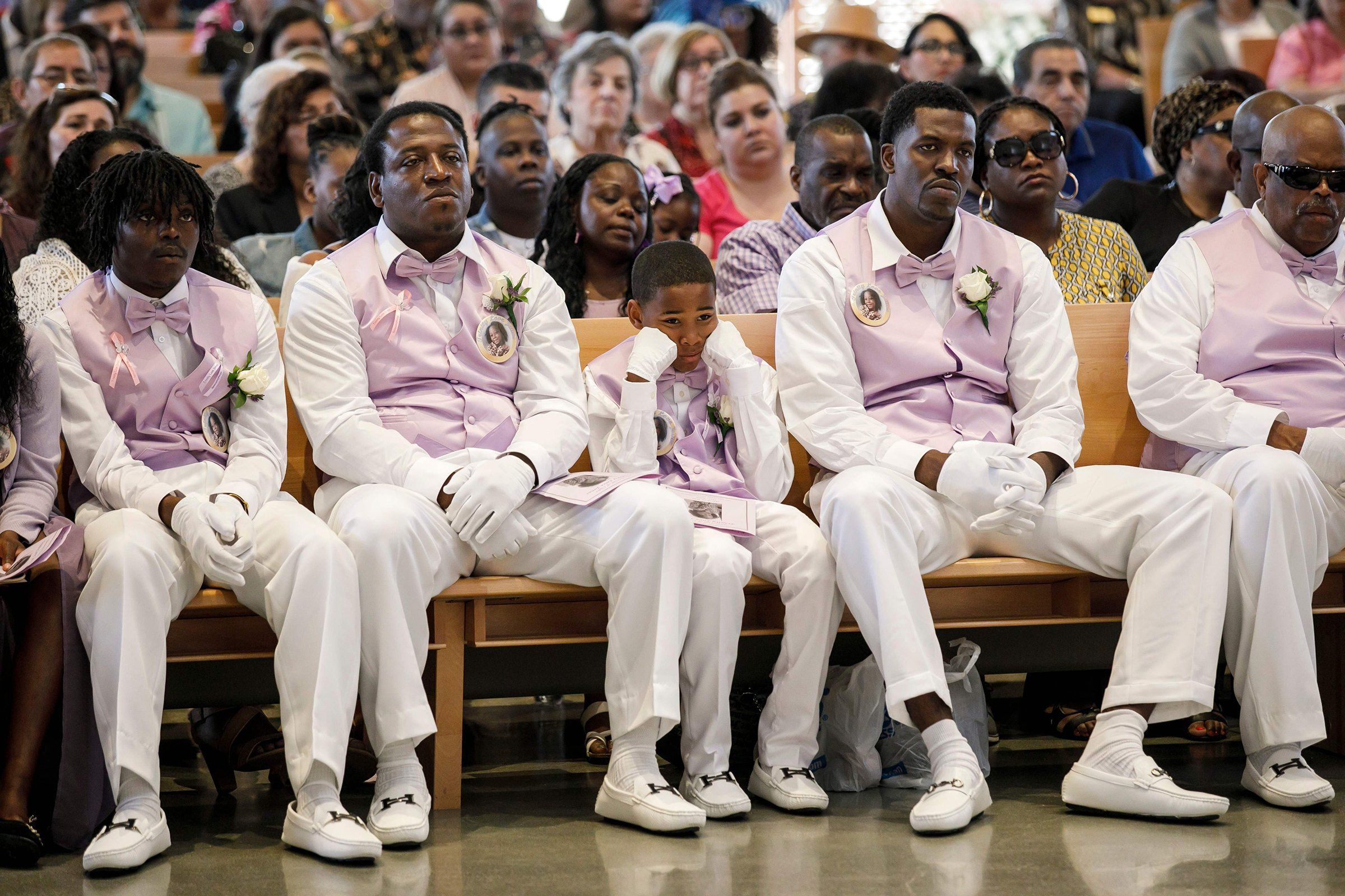 Pallbearers for the memorial service of Trinity Love Jones listen to a sermon on March 25. The 9-year-old's body was found in a duffel bag along a trail in Hacienda Heights, Calif.